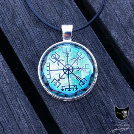 Original jewellery design featuring Viking wayfinder symbol, sealed under cabochon glass and strung on black cord