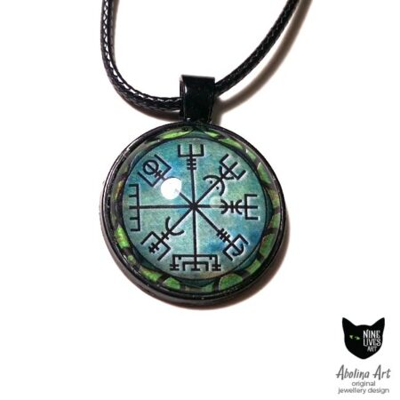 Vegvisir symbol on green background sealed under glass cabochon with black pendant setting and cord