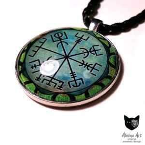 side view of green vegvisir art pendant featuring Viking wayfinder symbol