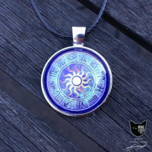 Art pendant featuring zodiac star signs with sun in centre on purple background