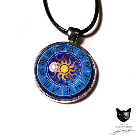 Star signs on blue background with sun in centre, sealed under glass cabochon & set in antique silver metal backing - original and handmade jewellery design