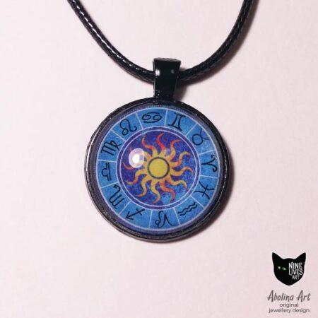 Zodiac pendant on black with sun symbol in the centre