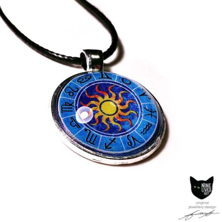Zodiac art pendant featuring star signs on blue background with yellow sun in centre