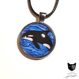 Artwork depicting Orca diving in ocean waves - 25mm silver coloured pendant setting with glass cabochon