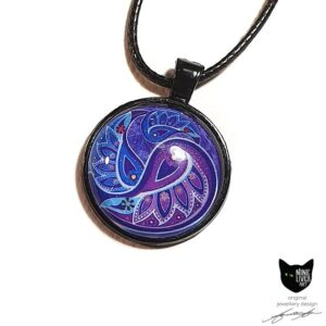Art pendant with paisley inspired artwork in purple violet hues in black bezel, with glass cabochon sealing the artwork