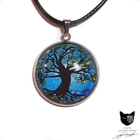 Tree of Life art pendant incorporating bright blue tones, sealed under cabochon, striking and original jewellery