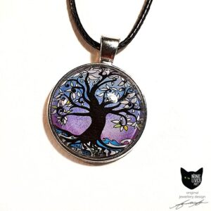 Art pendant featuring tree of life surrounded by lilac winter hues. Silver coloured pendant setting with glass cabochon