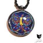 Striking art pendant featuring fairy in yellow dress surrounded by her beautiful wings on midnight blue background