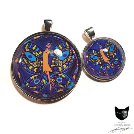 two art pendants featuring fairy in orange dress with purple, blue and yellow butterfly wings on a dark purple background - a striking 40mm pendant set on antique silver coloured bezel under cabochon glass