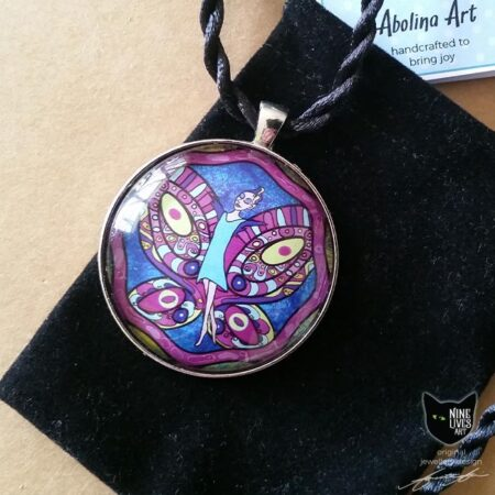 40mm Butterfly Fairy art pendant displayed on giftbag with Nine Lives Art tag