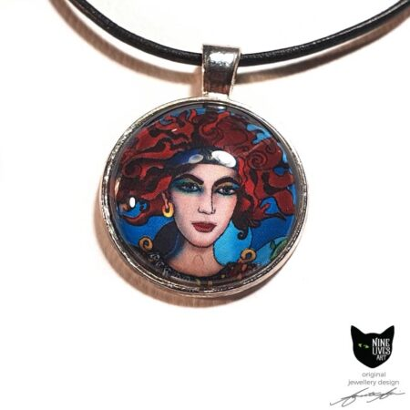 Art pendant featuring detail from Nine Lives Tarot Chariot card, woman in bright red hair, sealed under glass dome with bezel setting