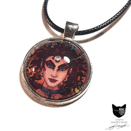 Art pendant featuring detail from Nine Lives Tarot - The Devil, sealed under glass dome with bezel setting