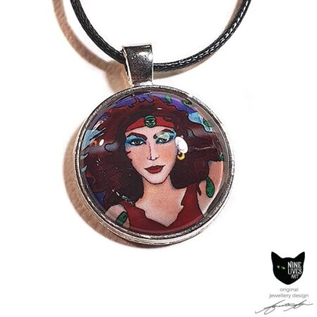 Art pendant featuring detail from Nine Lives Tarot - The Magician, sealed under glass dome with bezel setting