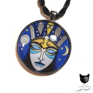 Art pendant featuring moon goddess with closed eyes on blue background, sealed under glass dome with silver coloured bezel and pendant cord
