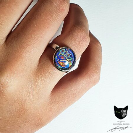 Model wearing 12mm blue paisley ring set under glass cabochon