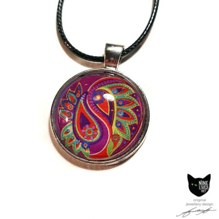 Art pendant with paisley inspired artwork in bold pink and green with glass cabochons sealing the artwork