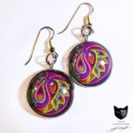 Paisley inspired artwork in bold pink and green - 25mm silver coloured earring settings with glass cabochons sealing the artwork