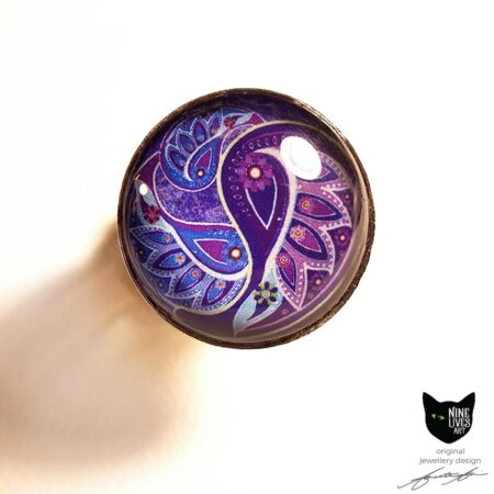 Paisley inspired artwork in purple hues - 25mm silver coloured adjustable ring setting with glass cabochon