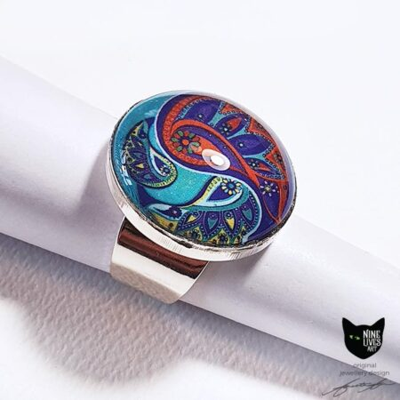 Adjustable ring setting with 25mm cabochon sealing artwork in bright jade and orange hues