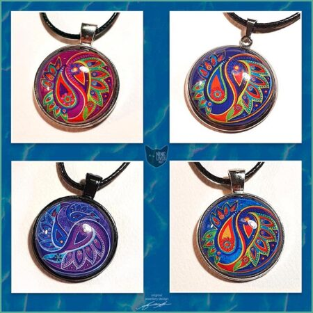 Four paisley inspired art pendants in vibrant colours, 25mm round bezel settings with artwork sealed under glass cabochon