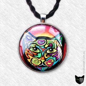 Colourful original pendant featuring a cat sealed under glass cabochon and strung on cord