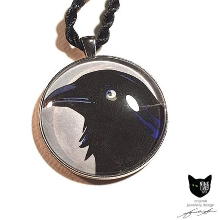 Art pendant featuring the head of a black raven