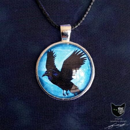 Black raven flying on a turquoise blue sky background - 25mm silver coloured pendant setting with glass cabochon