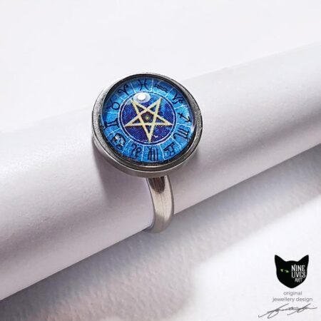 Ring featuring zodiac star signs with pentagram in centre