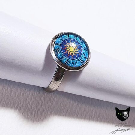 Gorgeous blue ring setting in hypoallergenic stainless steel featuring 12mm cabochon setting with zodiac artwork