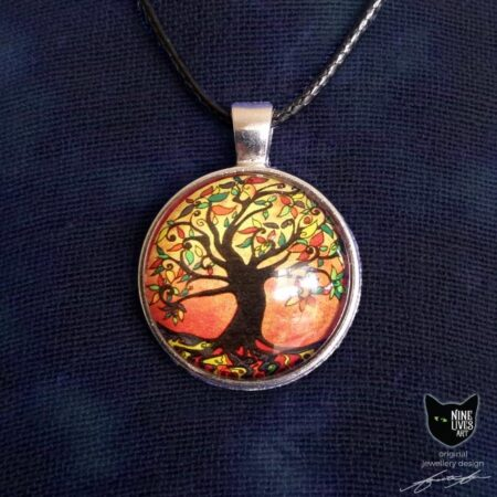 Black silhouette of tree with painted leaves on rusty autumn coloured background - 25mm silver coloured pendant setting with glass cabochon