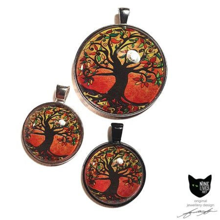 25mm and 40mm Tree of Life art pendants with silver coloured and black pendant setting - rusty warm colours in the artwork make these striking to wear