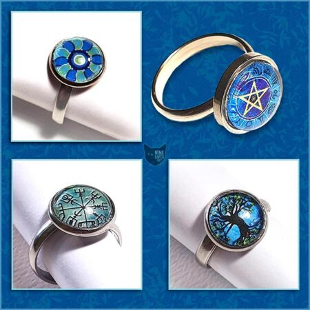 Collection of 12mm glass dome art rings displayed on blue background