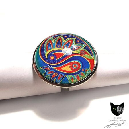 Jade blue paisley flower art ring set in stainless steel base with glass cabochon sealing artwork