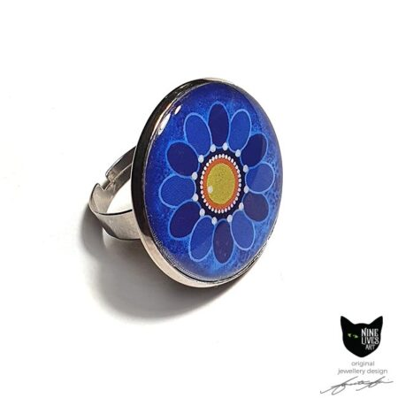 Blue Sunflower art ring sealed under 25mm flat resin disc in tarnish free adjustable ring base