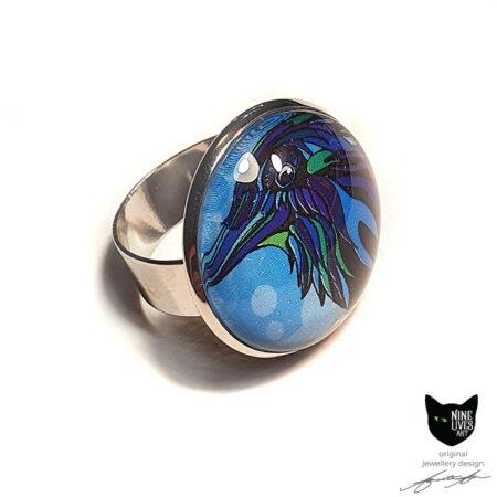 Blue Raven artwork sealed under glass cabochon & set in adjustable ring base