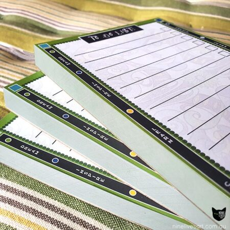 Close-up view of 3 to-do lists showing notepad thickness and border design in green