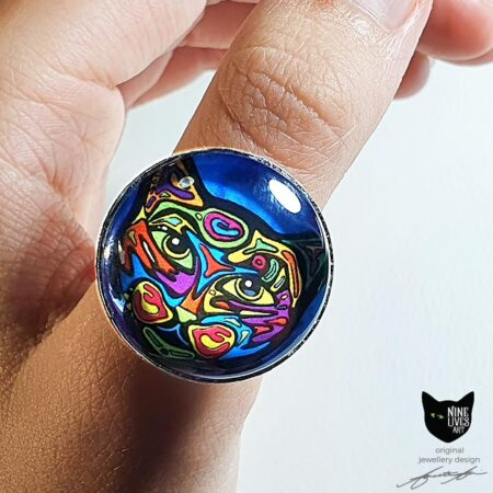 Model wearing Psychedelic cat in blue - 25mm glass dome ring setting with adjustable silver coloured base