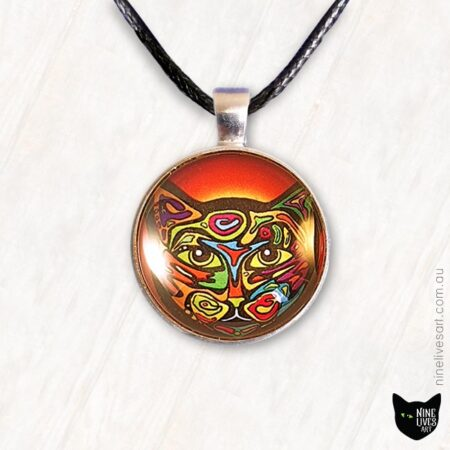 Bright and colourful cat pendant in 25mm cabochon setting