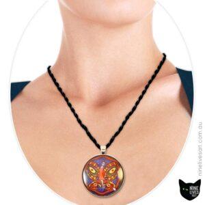 Model wearing 40mm Red Fairy pendant on indigo blue