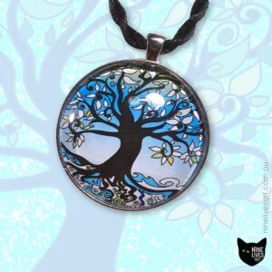 Tree of Life pendant strung on cord displayed on a faint blue background with tree artwork